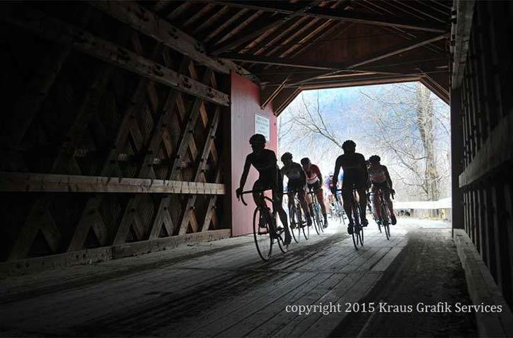 bikers on a covered bridge