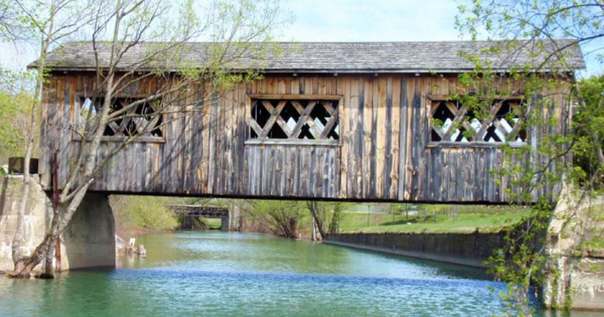 a covered bridge over water