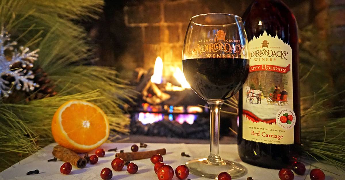 Adirondack Winery's holiday cranberry wine set up by a fire