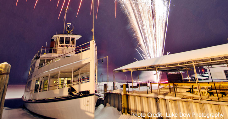 fireworks in winter near a ship
