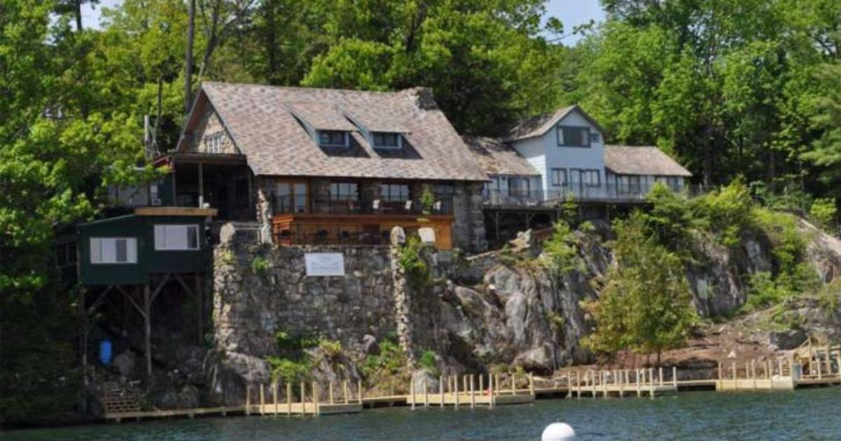 manor on a cliff overlooking the water