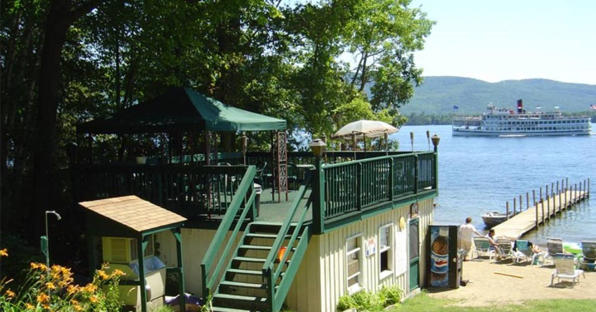 patio area and boat dock in lake