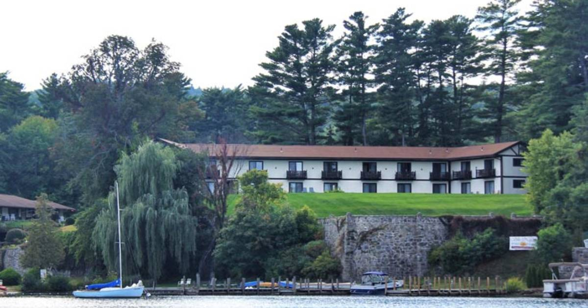 view of lodging property on a small cliff overlooking a lake