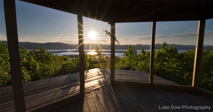 view of lake george at sunrise from pilot knob gazebo