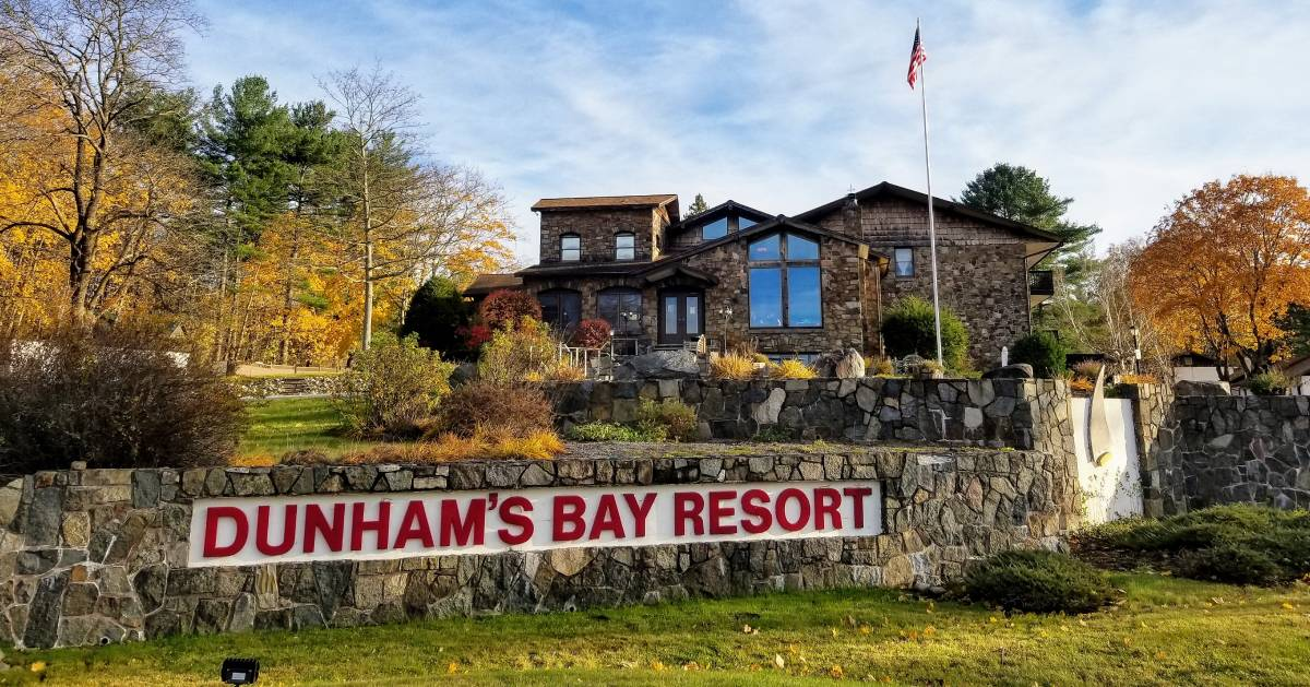 Dunham's Bay Resort sign in front of buildign