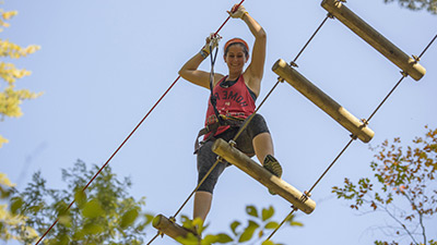 person on a ropes course