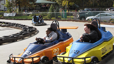people riding go karts