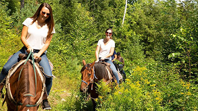 people horseback riding