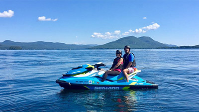 people on a jetski in lake george