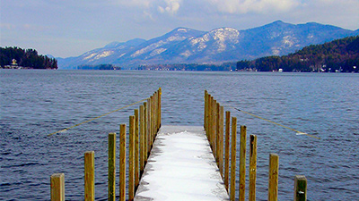 view from the end of a dock on lake george in winter