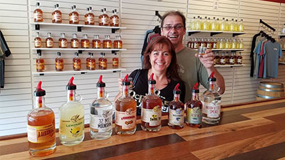 two people with lake george distilling co spirits