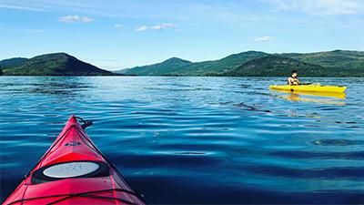 two people kayaking on a lake