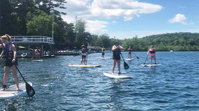 people on stand-up paddle boards
