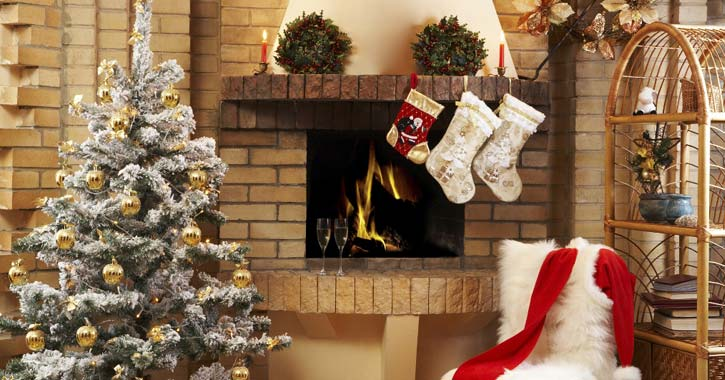 a room with fireplace and Christmas decor