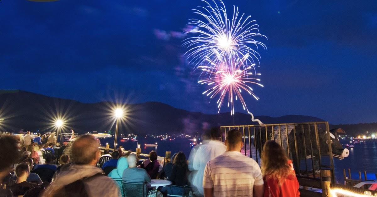 people on restaurant deck watching fireworks