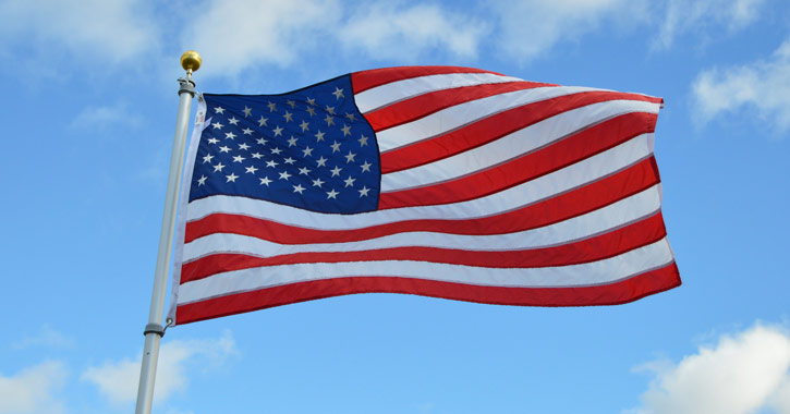 american flag with blue sky background