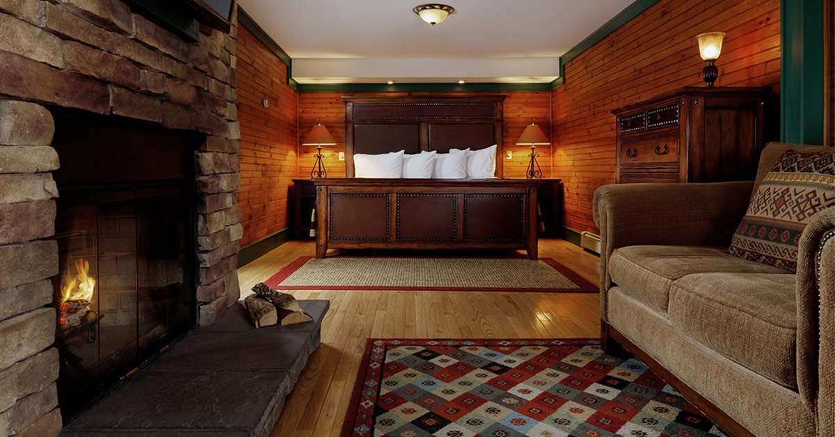 guest room with a fireplace at friends lake inn