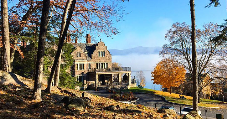 stone inn near fall trees