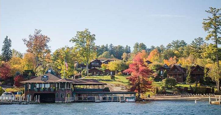 lodging near shoreline with fall foliage