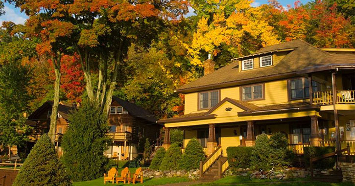 large rustic house near fall trees