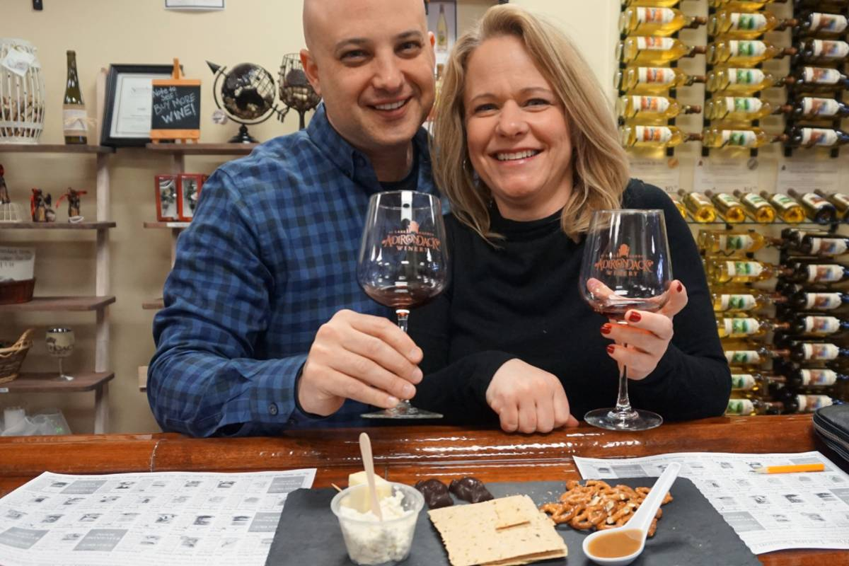 a couple enjoying a food and wine tasting