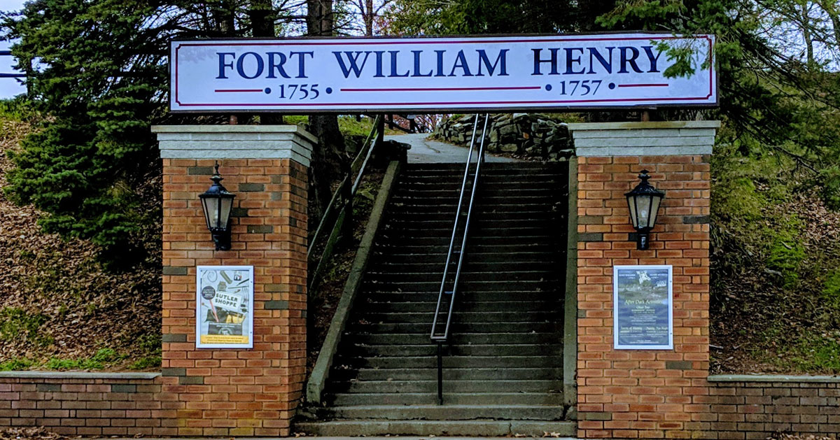 stairs leading up to Fort William Henry with sign