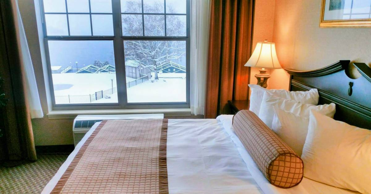 hotel room with window view of winter