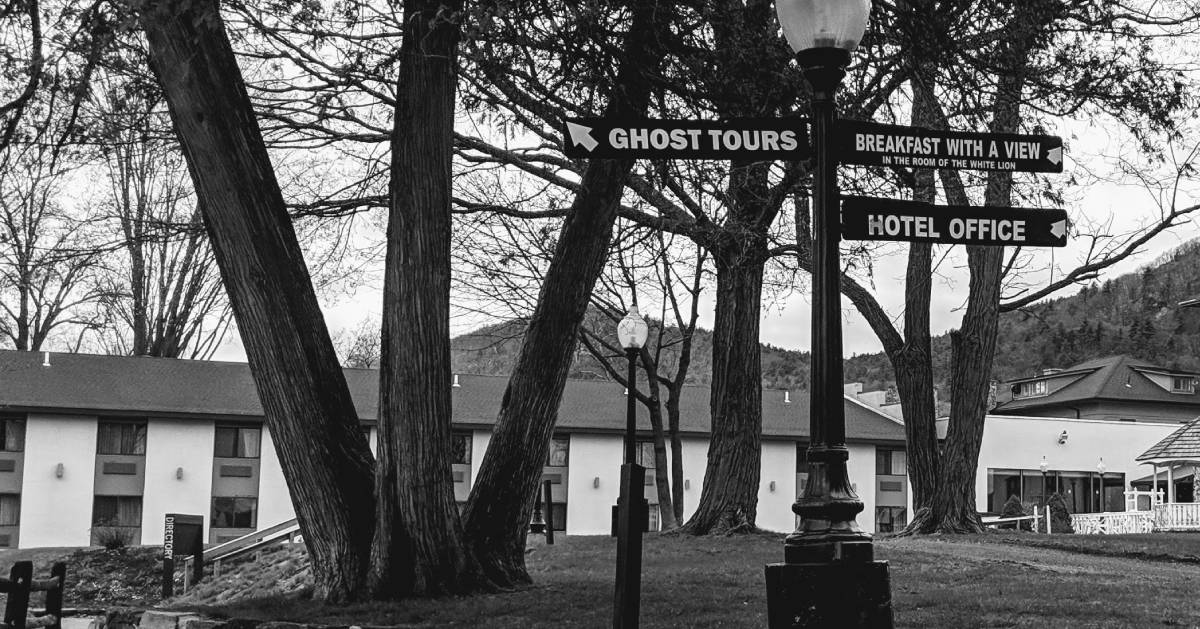 black and white photo of ghost tours sign