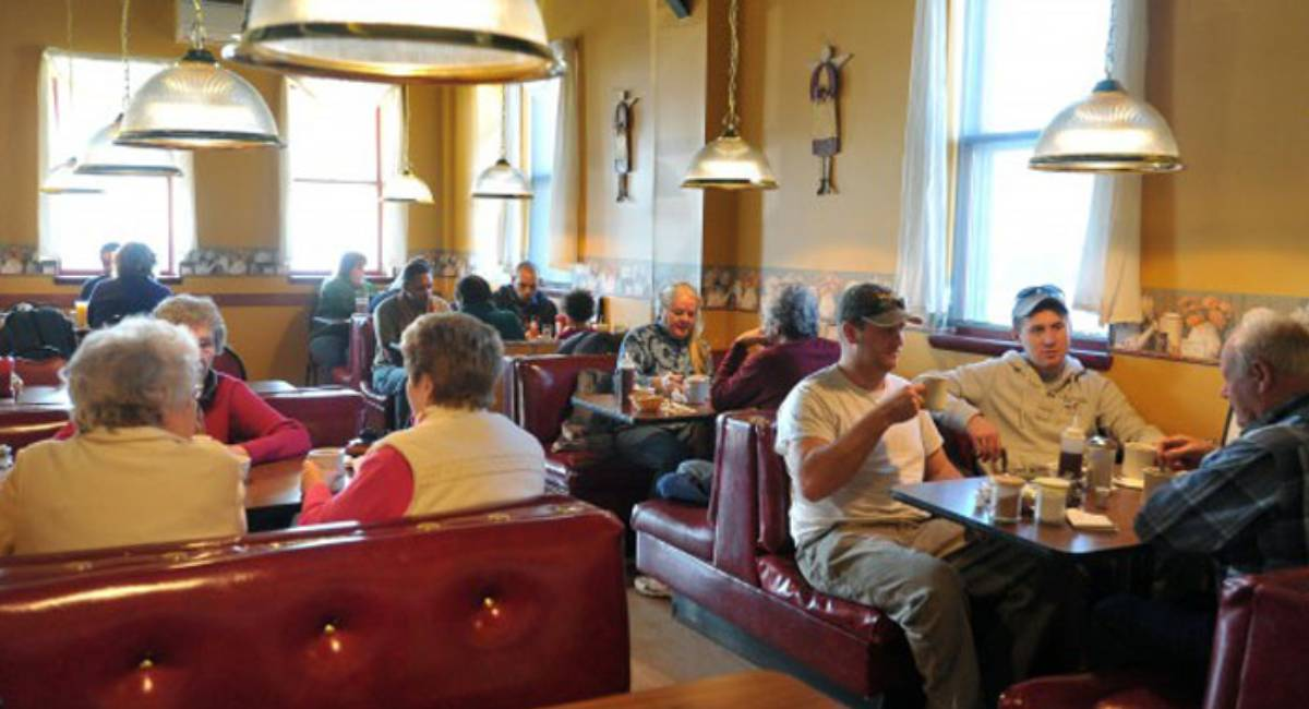 people eating inside a diner