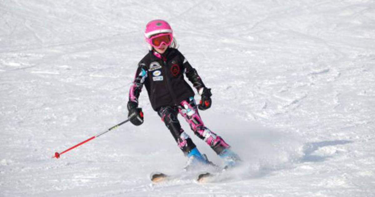 a girl skiing downhill
