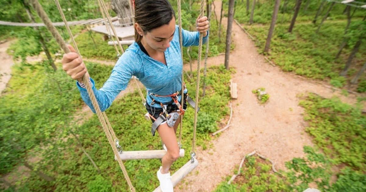 woman going down a zipline