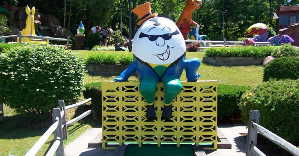 Humpy Dumpy sitting on a wall as part of a mini-golf course