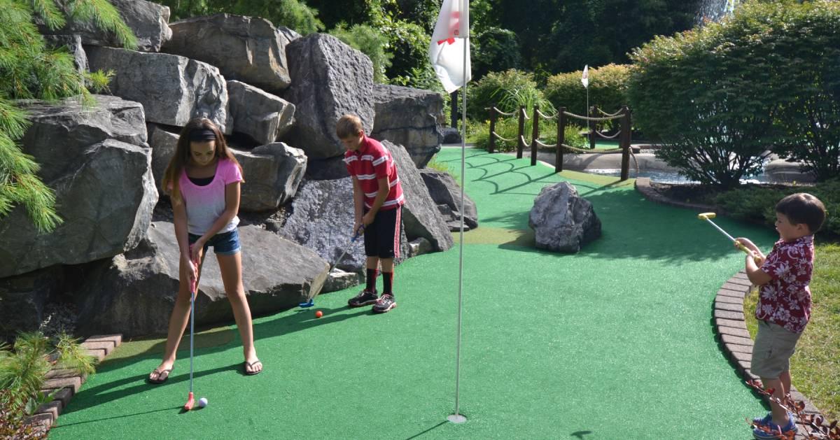 kids playing mini-golf