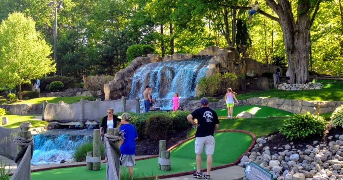 people on a mini golf course