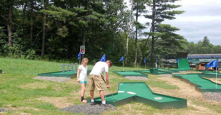 two people mini golfing