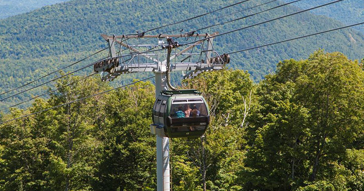 gondola traveling up mountain in summer