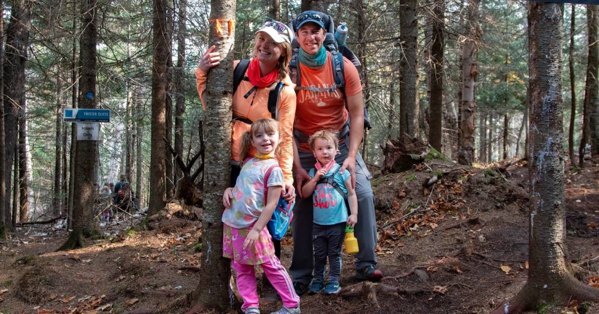 family of four hikers