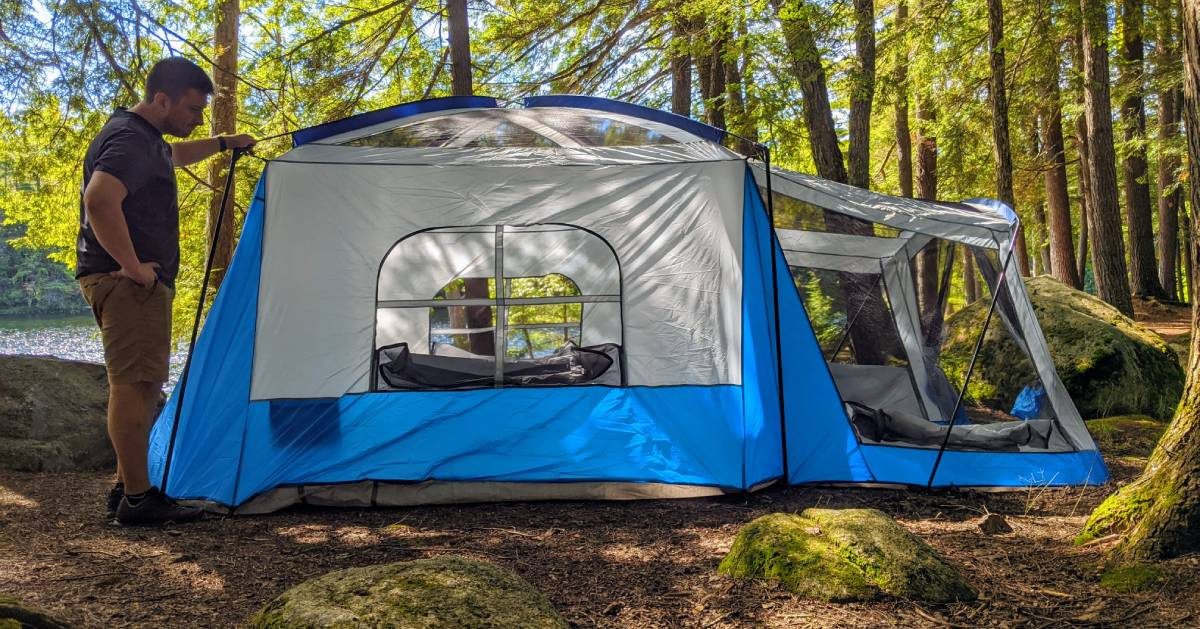 guy with camping tent in woods