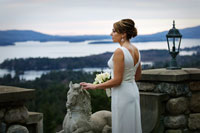 bride overlooking lake george at highlands castle