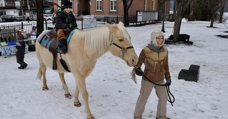 lake george pony ride during carnival in winter