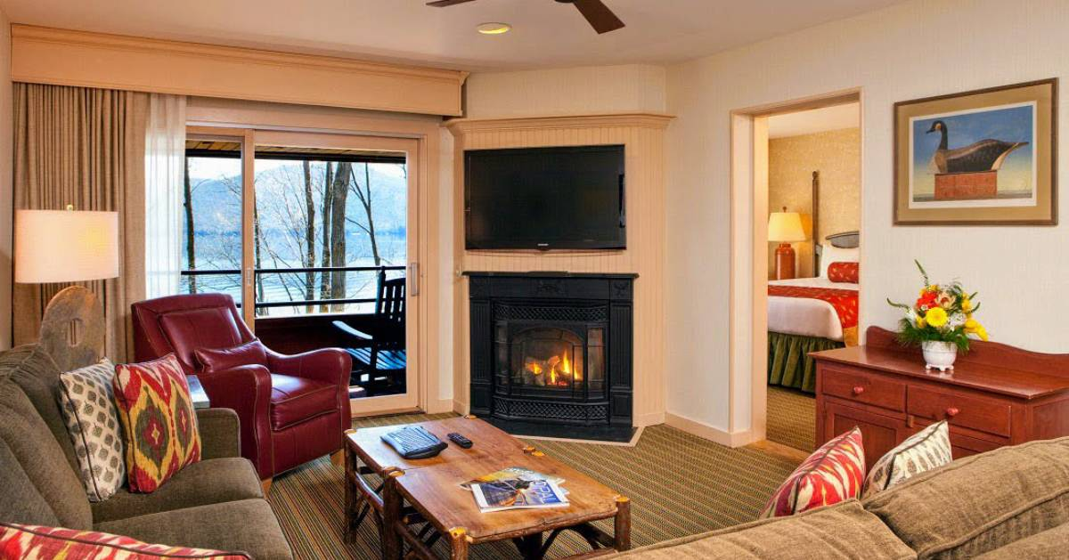 hotel suite with fire in fireplace