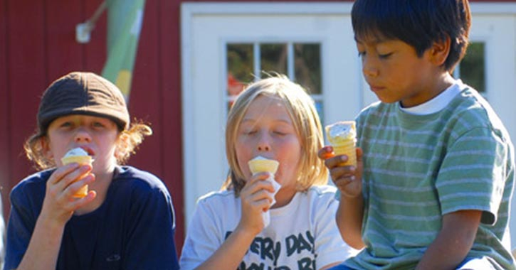 three kids eating ice cream