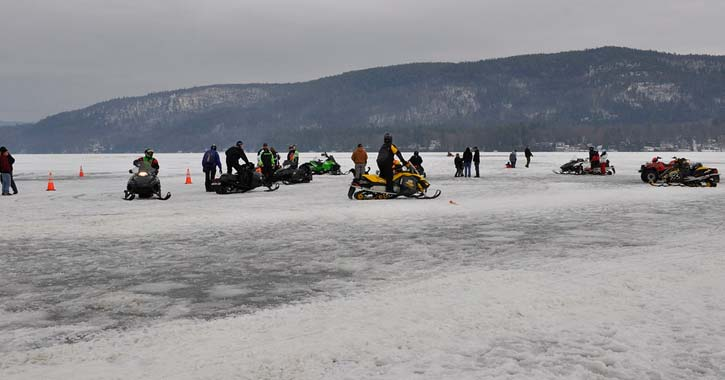 snowmobiles on a frozen lake
