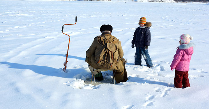 two kids near ice fisherman