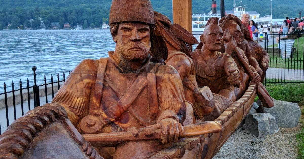 statue of Indians and trappers in rowboat