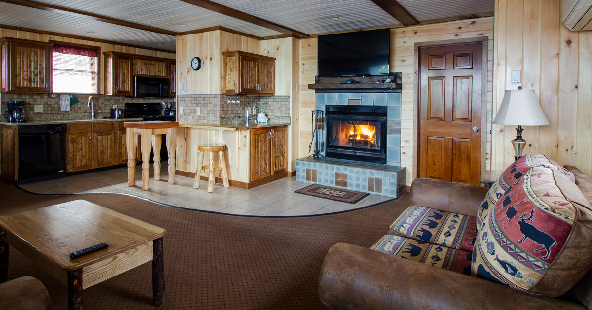 inside a nicely furnished cabin with fireplace