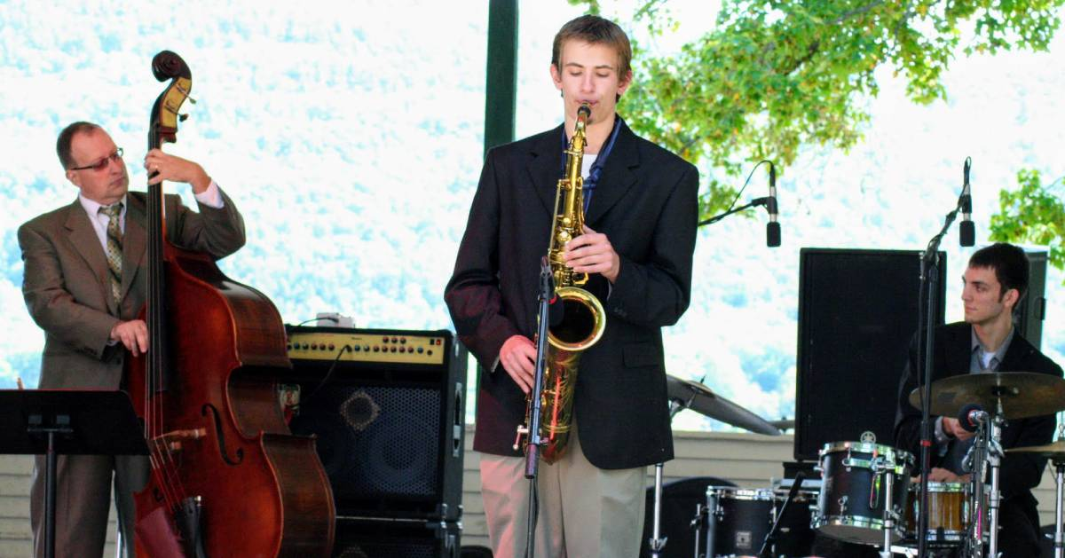 three people playing jazz on stage