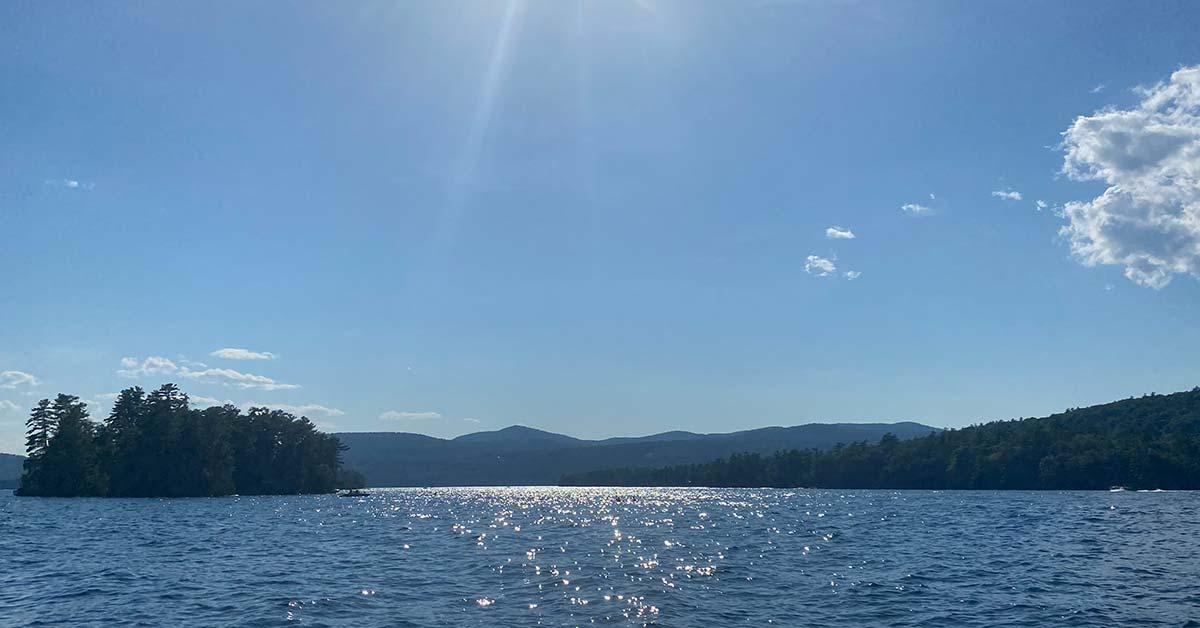 kayaks on lake barely visible