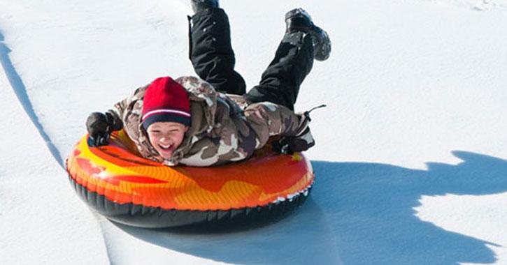 boy on snow tube