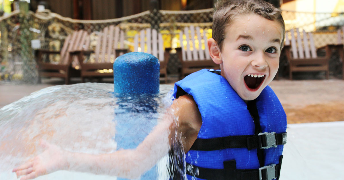 a kid in a water park